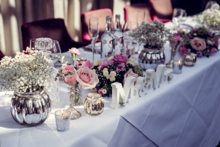 Vintage vases tea light candles sweet avalanche pink carnations  studley wedding florist Top table vintage vases at Hampton Manor