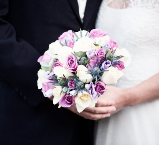 bridal bouquet Hand tied of roses thistle and lisianthus