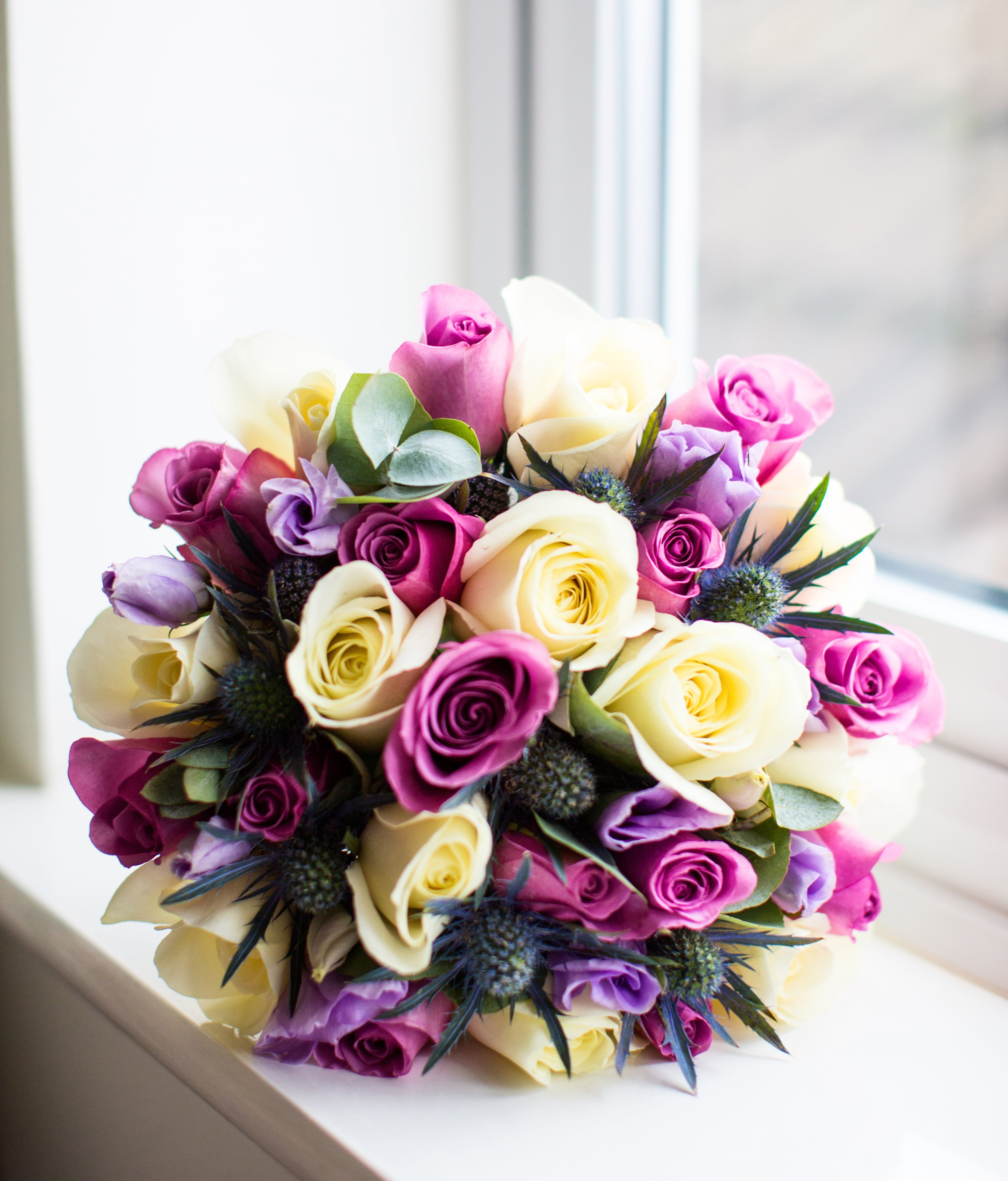 hand tied of roses thistle and lisianthus