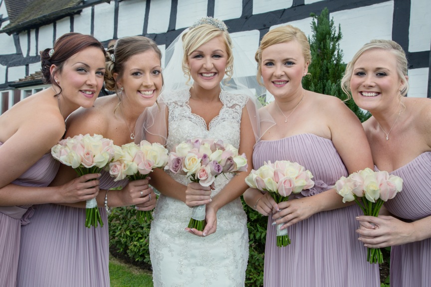 Bridal party flowers lilacs ivory & chocolate roses