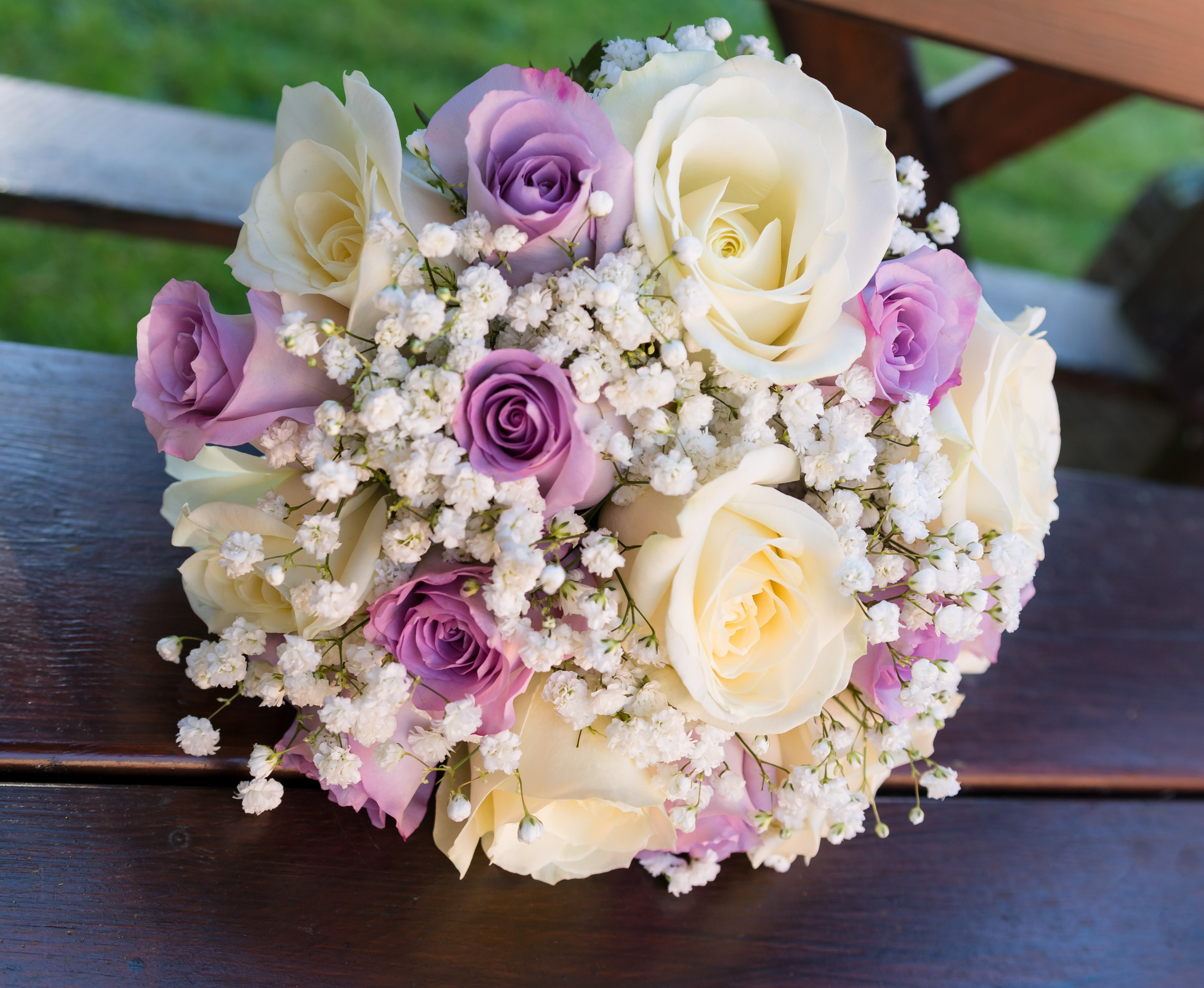 bridal bouquet of lilac roses with ivory roses and gypsophila hand tied wedding bouquet