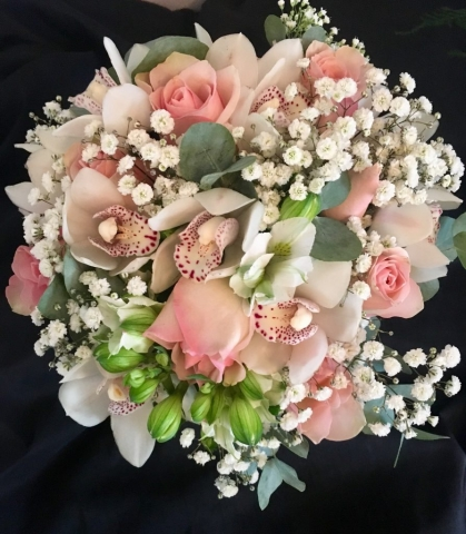 bridal bouquet hand tied touches of gypsophila and roses with orchids and alstro