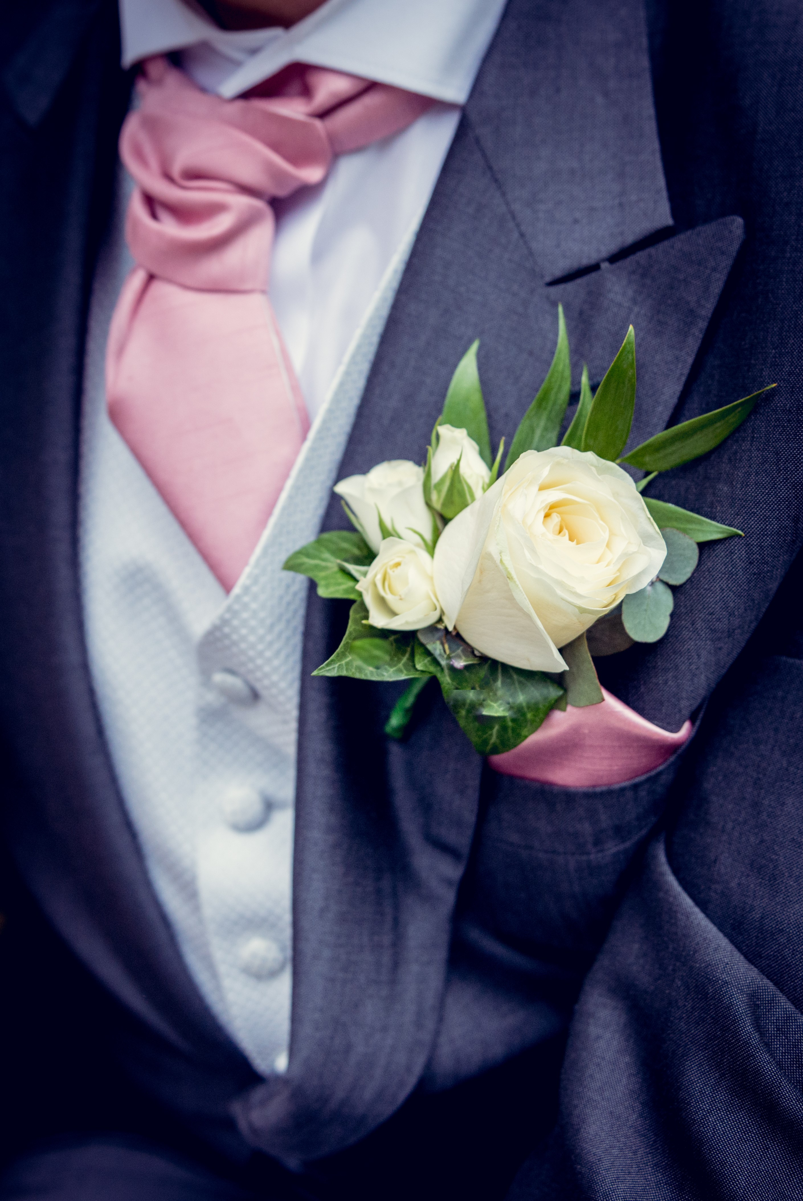 Ivory rose with spray roses blue suit flowers