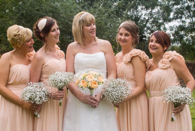 gypsophila and roses bridal bouquet and bridesmaids flowers