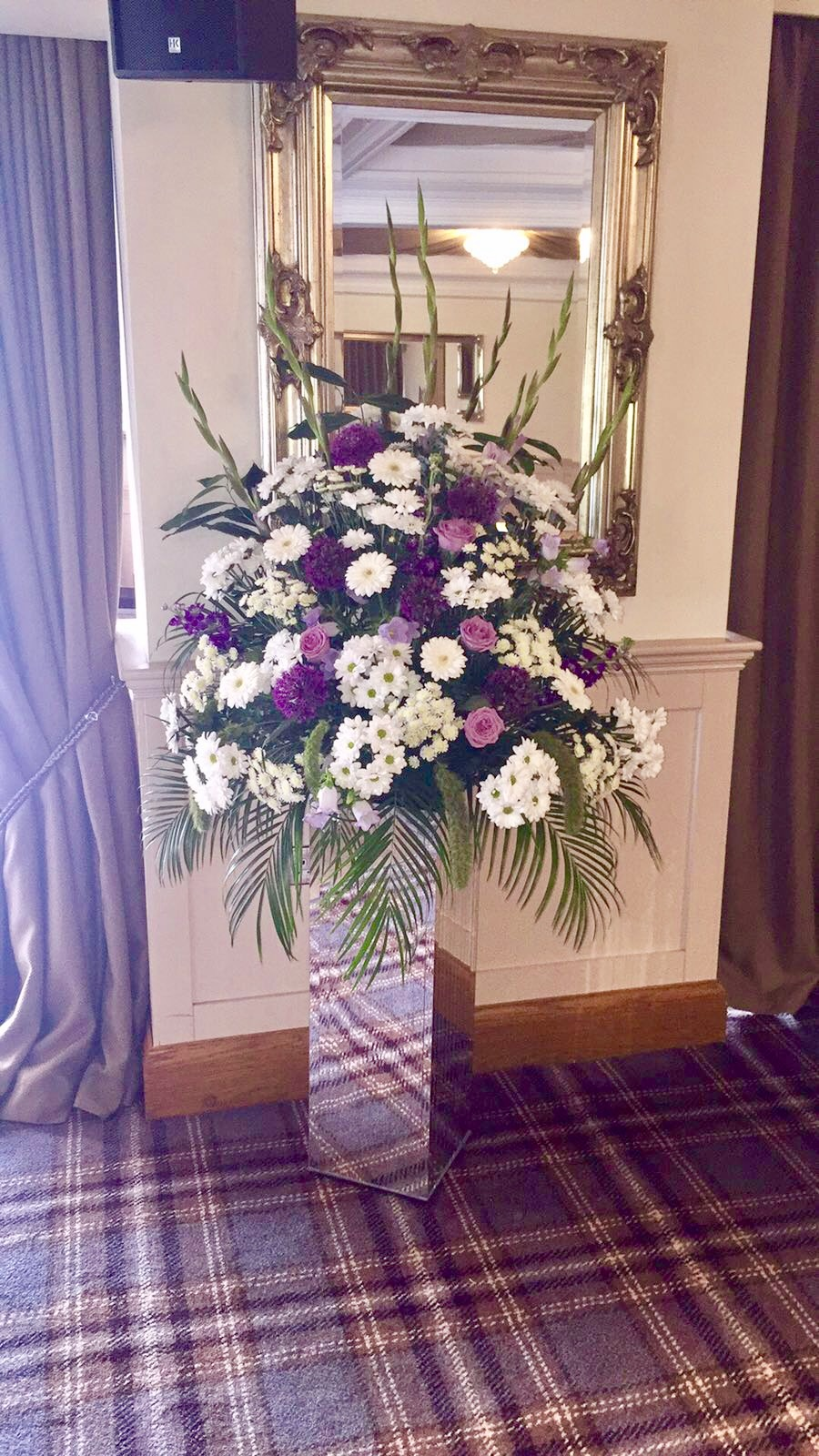 pinks & purple arrangement on glass pedestal florist in studley