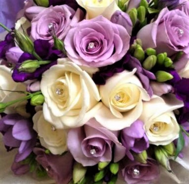 lilac roses with ivory roses and purple lisianthus hand tied wedding bouquet