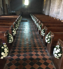 Church aisle pew ends white flowers
