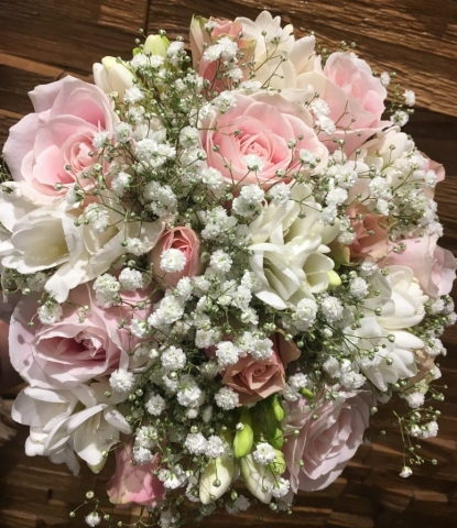 bridal bouquet pastel flowers in bouquet white roses and pale pink hand tied bouquet