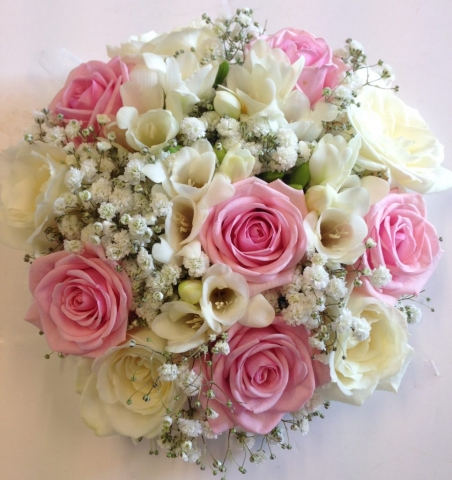 bridal bouquet of roses and ivory freesia  gypsophila