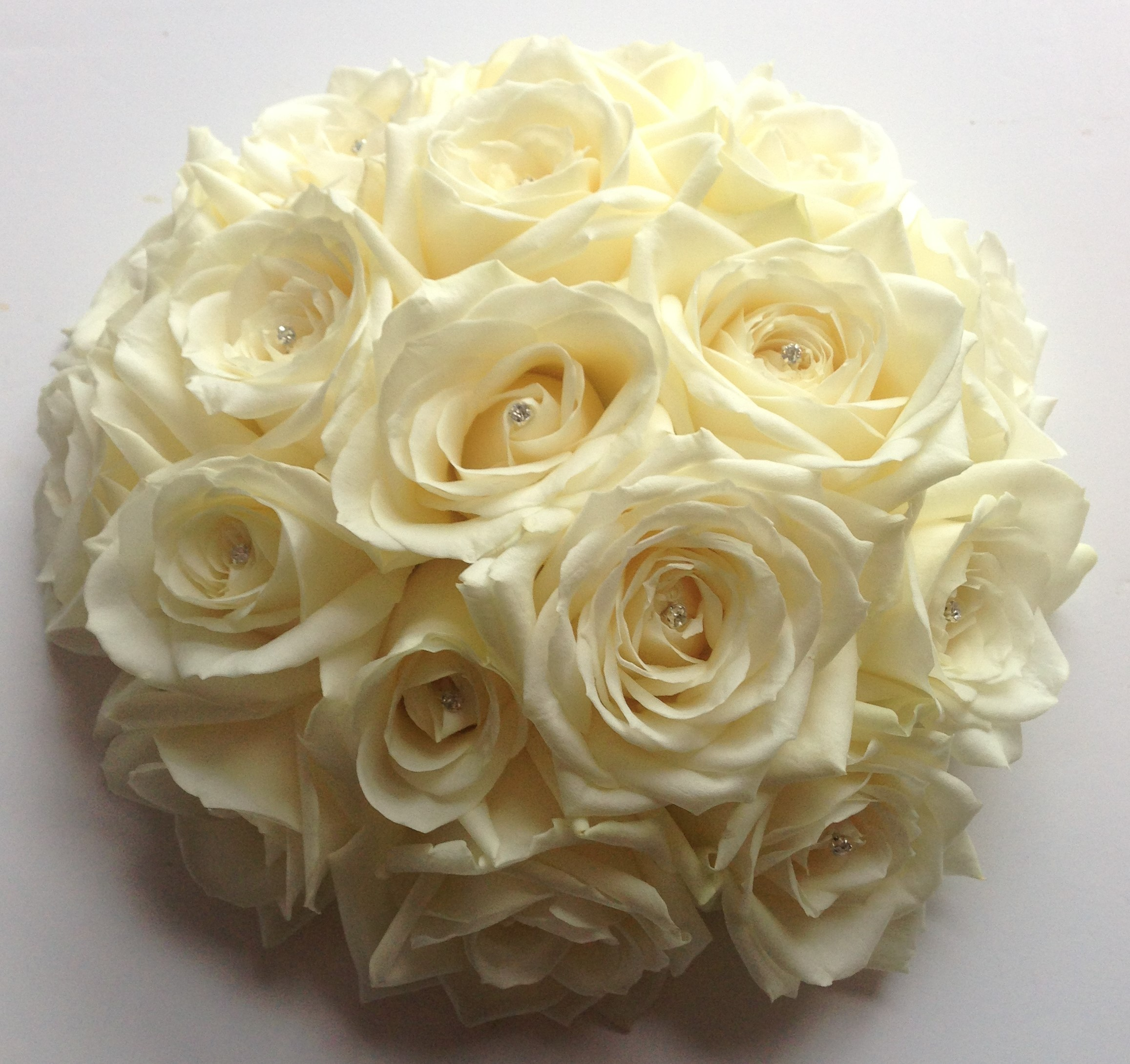 wedding flowers for bride in a hand tried style just roses and diamante