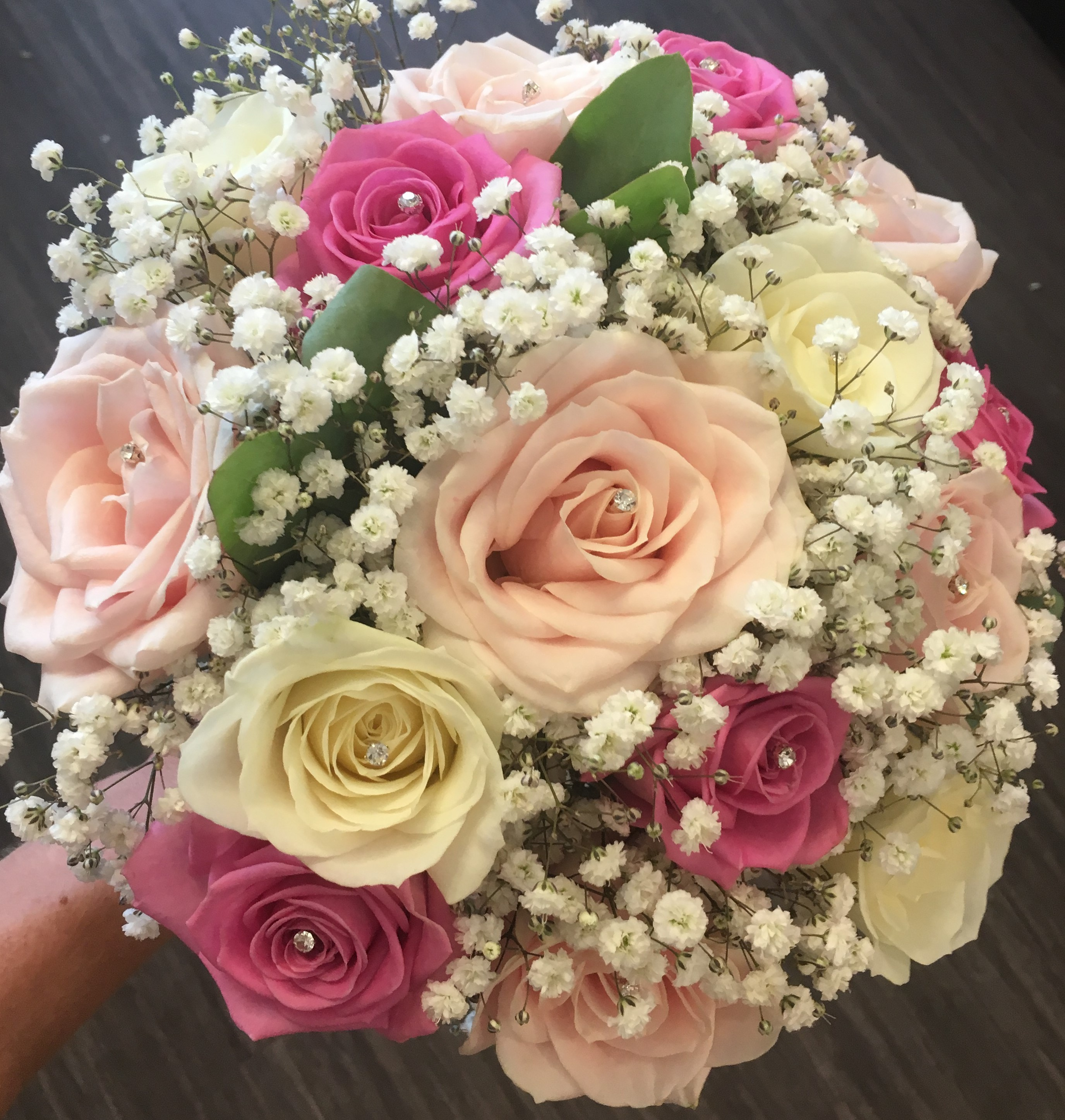 bridal bouquet of pastel pink dark pink roses and ivory roses gypsophila