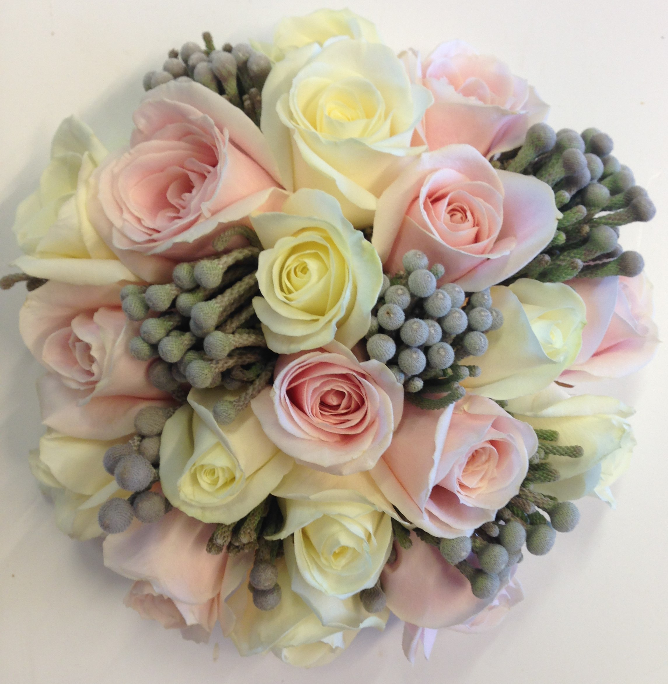 pastel pink roses with white roses and grey berries  wedding flowers