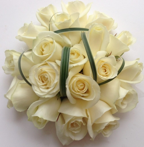 wedding flowers for bride in a hand tied style just roses china grass foliage