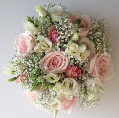 bridal bouquet of roses and ivory freesia  lisianthus gypsophila