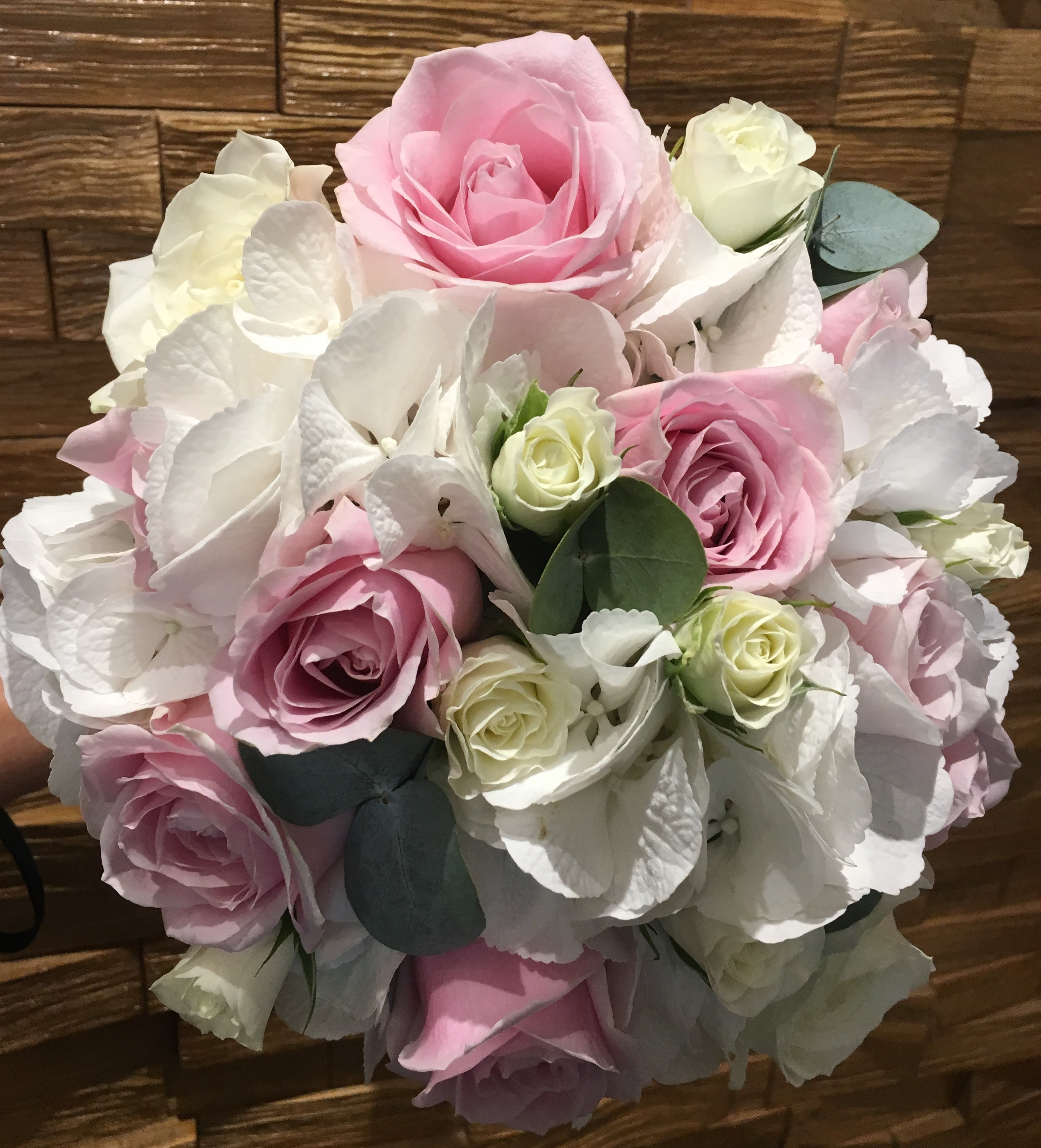 bridal bouquet of roses and ivory hydrangea eucalyptus