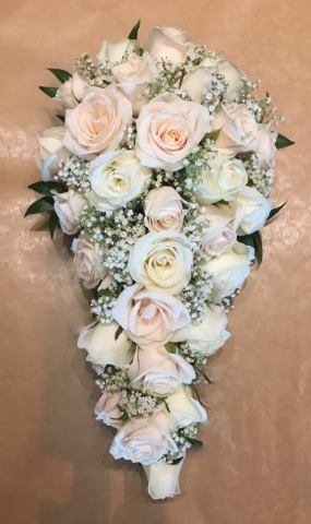 bridal bouquet of roses and  gypsophila eucalyptus