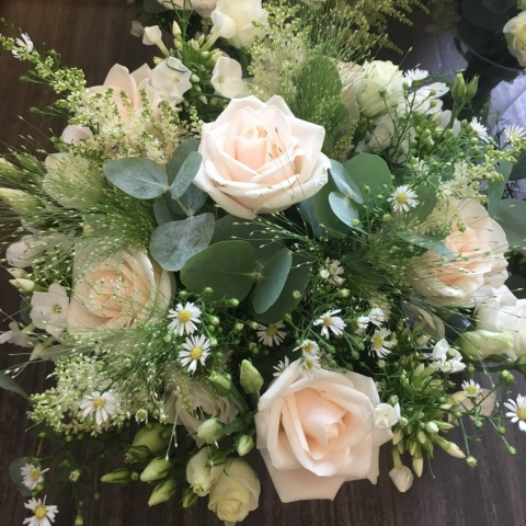 rustic wild theme wedding hand tied bouquet of roses and foliages