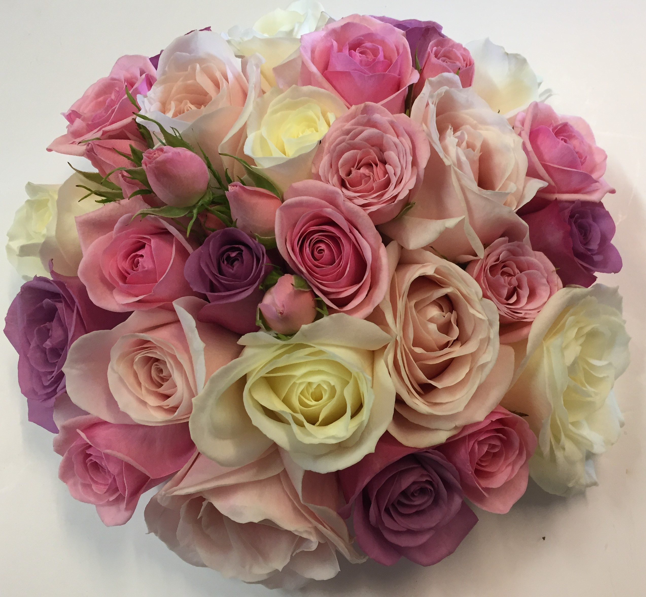 wedding flowers for bride in a hand tied style just roses