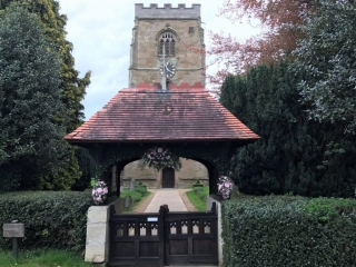 church gate entrance of flowers