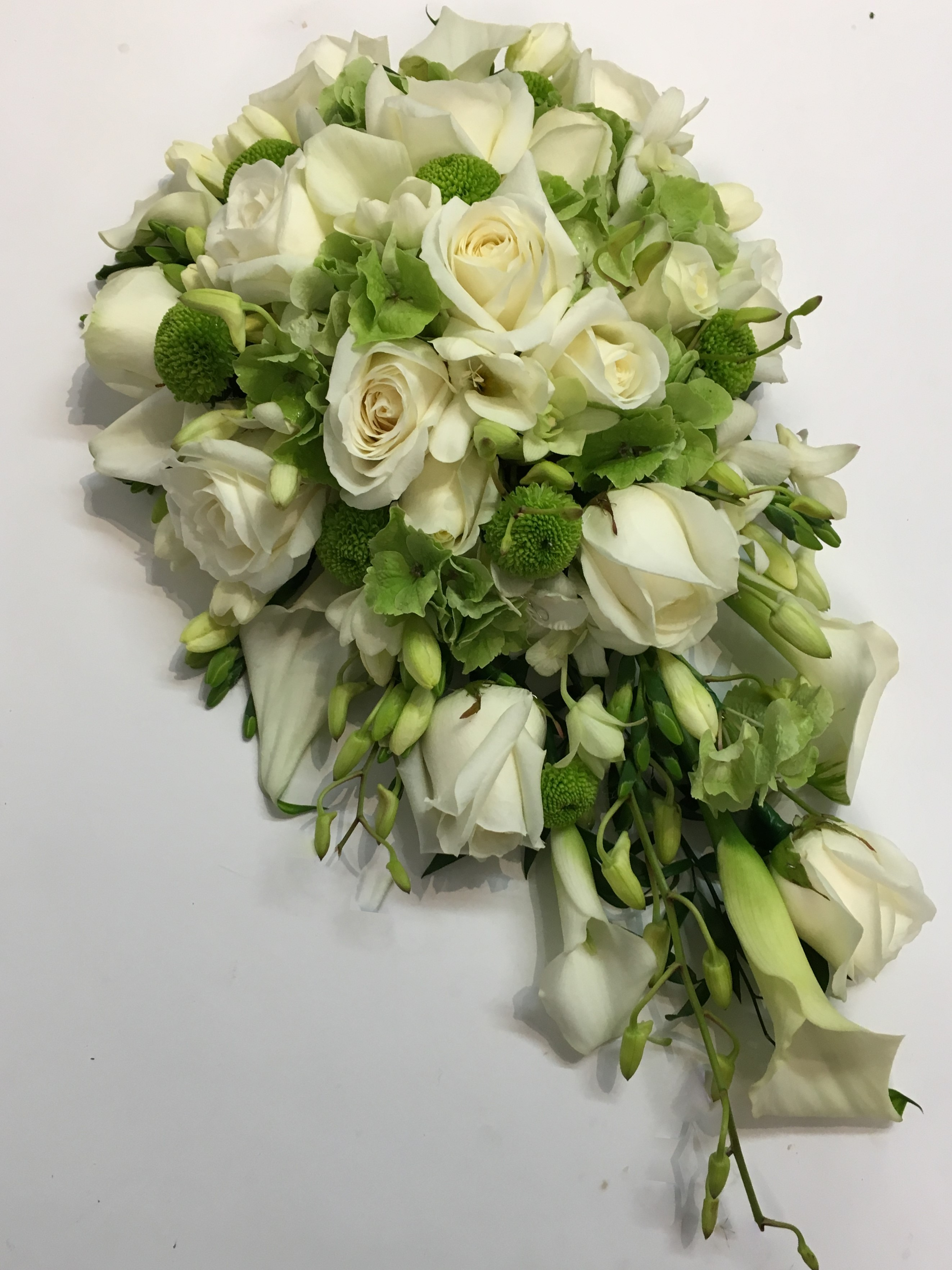 white rose and white freesia calla and singapore orchids shower wedding bouquet