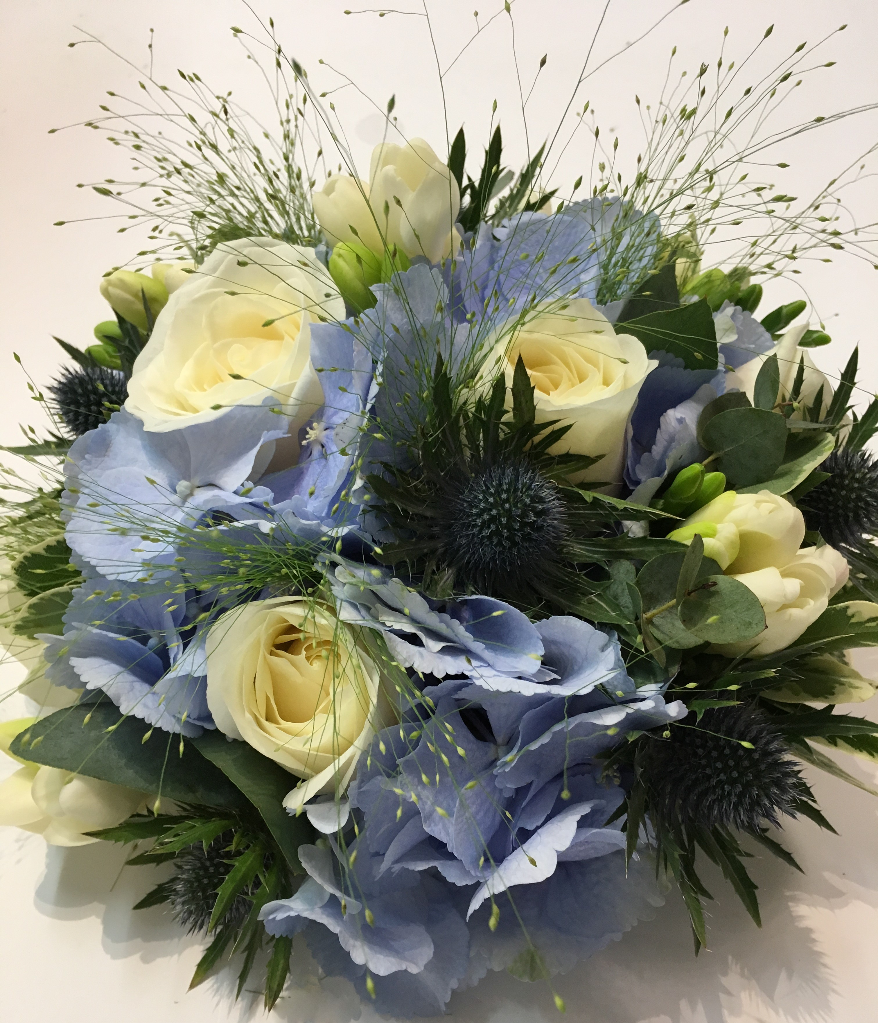hand tied of roses thistle and lisianthus  freesia and hydrangea wild country style