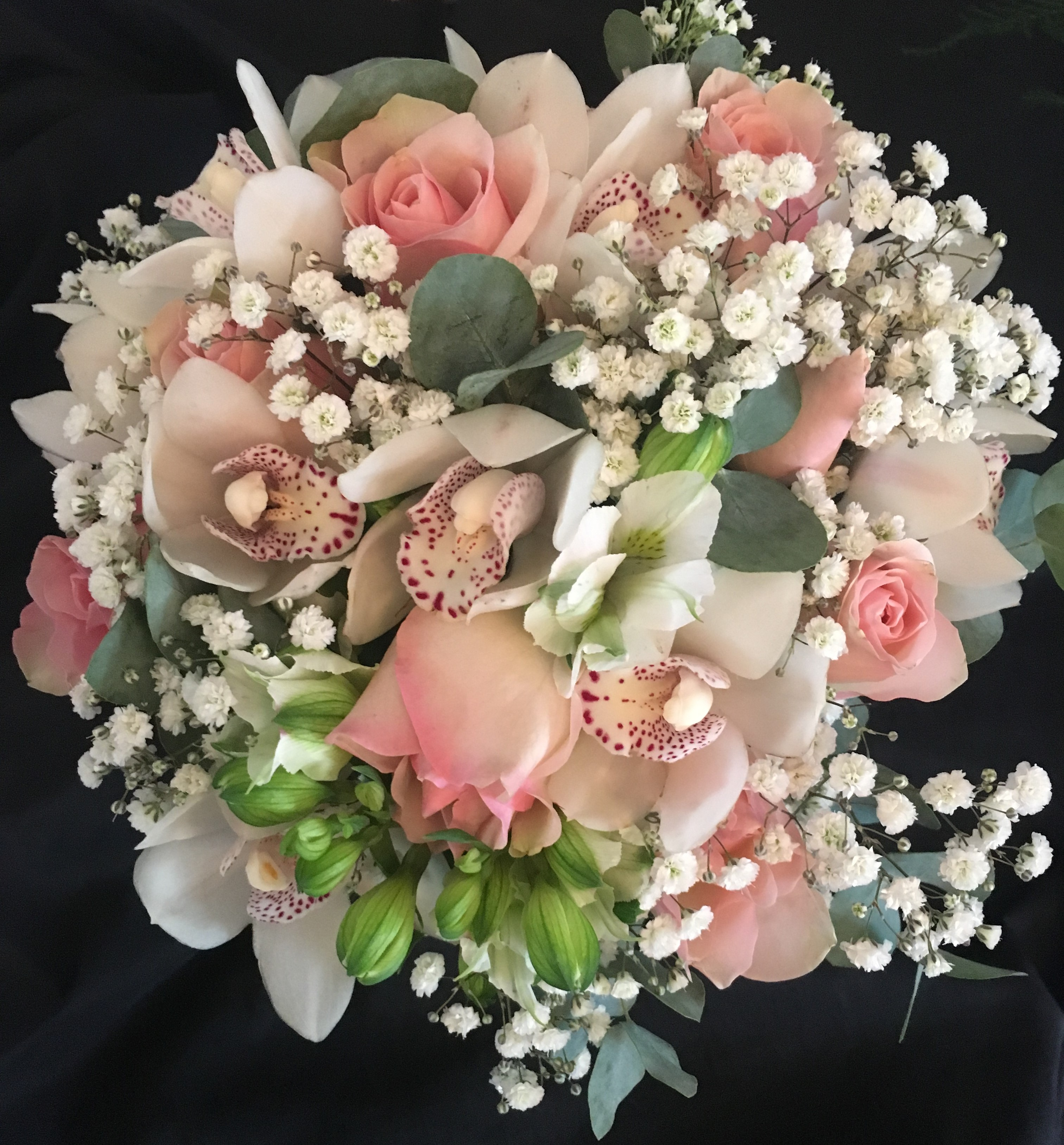 bridal bouquet of roses and ivory freesia  gypsophila eucalyptus