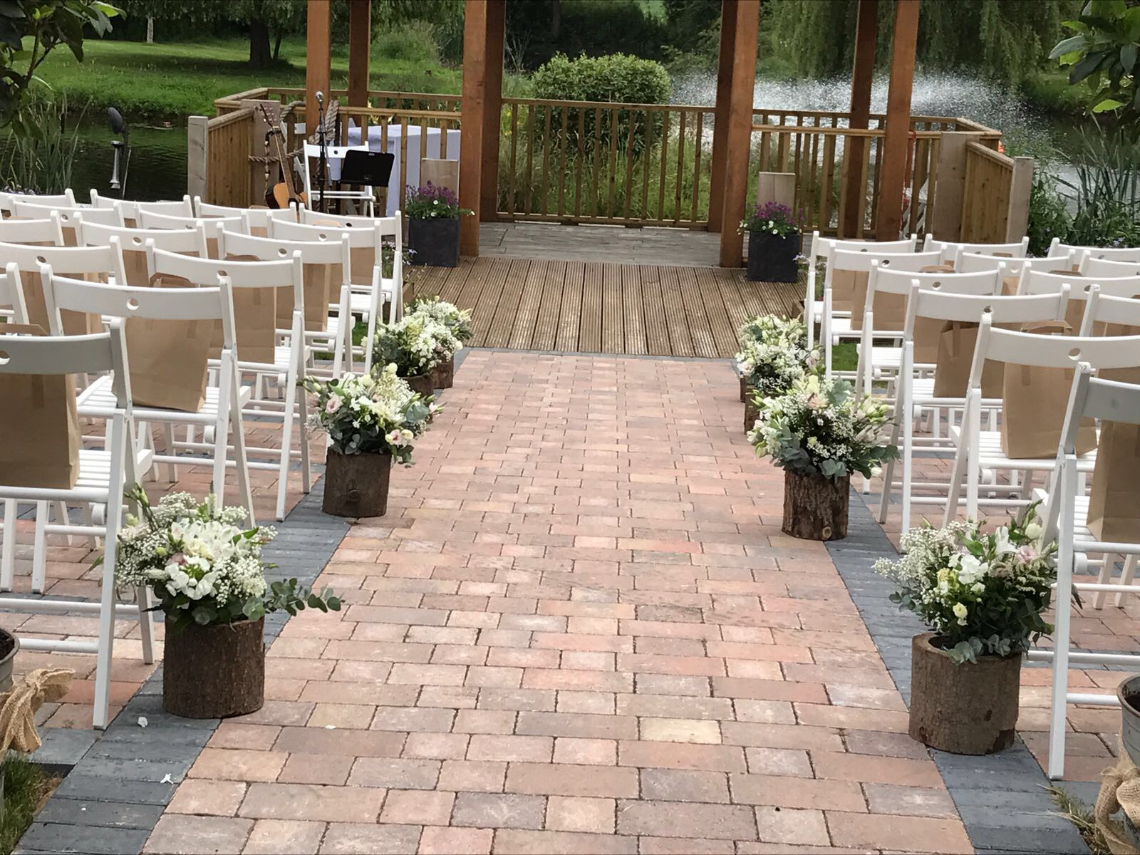 rustic look aisle outside weddings wootten park
