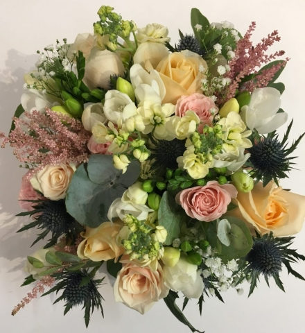 country style wedding flowers hand tied with peach roses and soft pinks