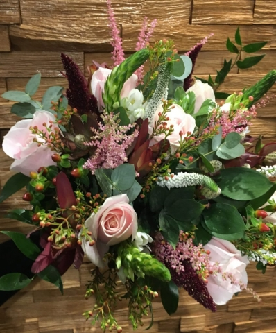 rustic wild theme wedding bouquet of roses lisianthus and freesia veronica and wax flower and foliages