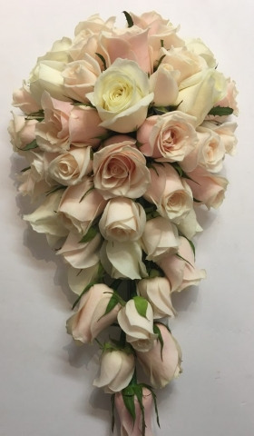 wedding flowers for bride in a hand tied style just pastel pink and ivory roses