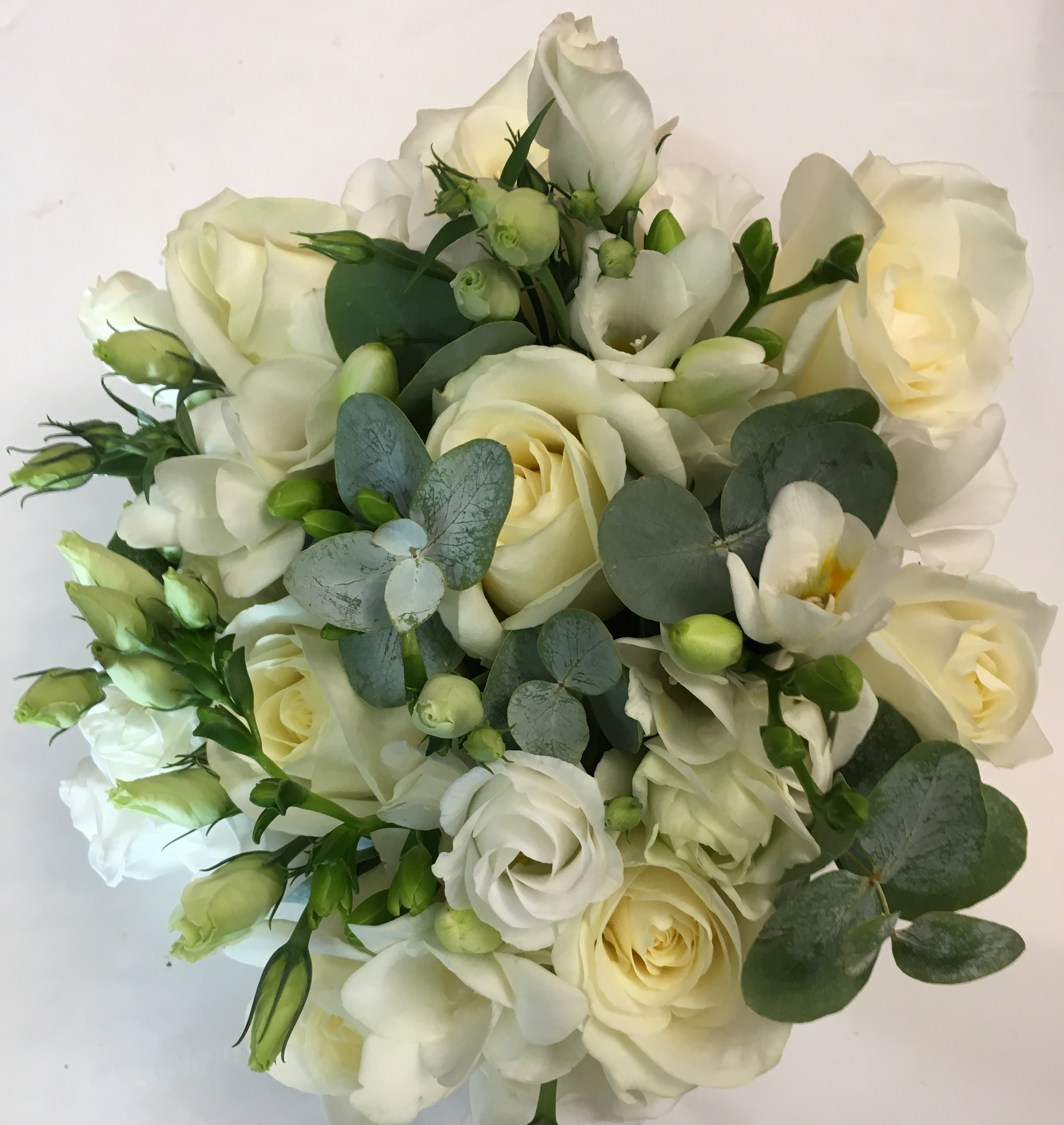 ivory roses & freesia with eucalyptus & lisianthus