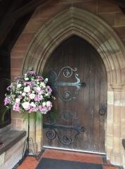 Pink & white pedestal arrangement church doorway