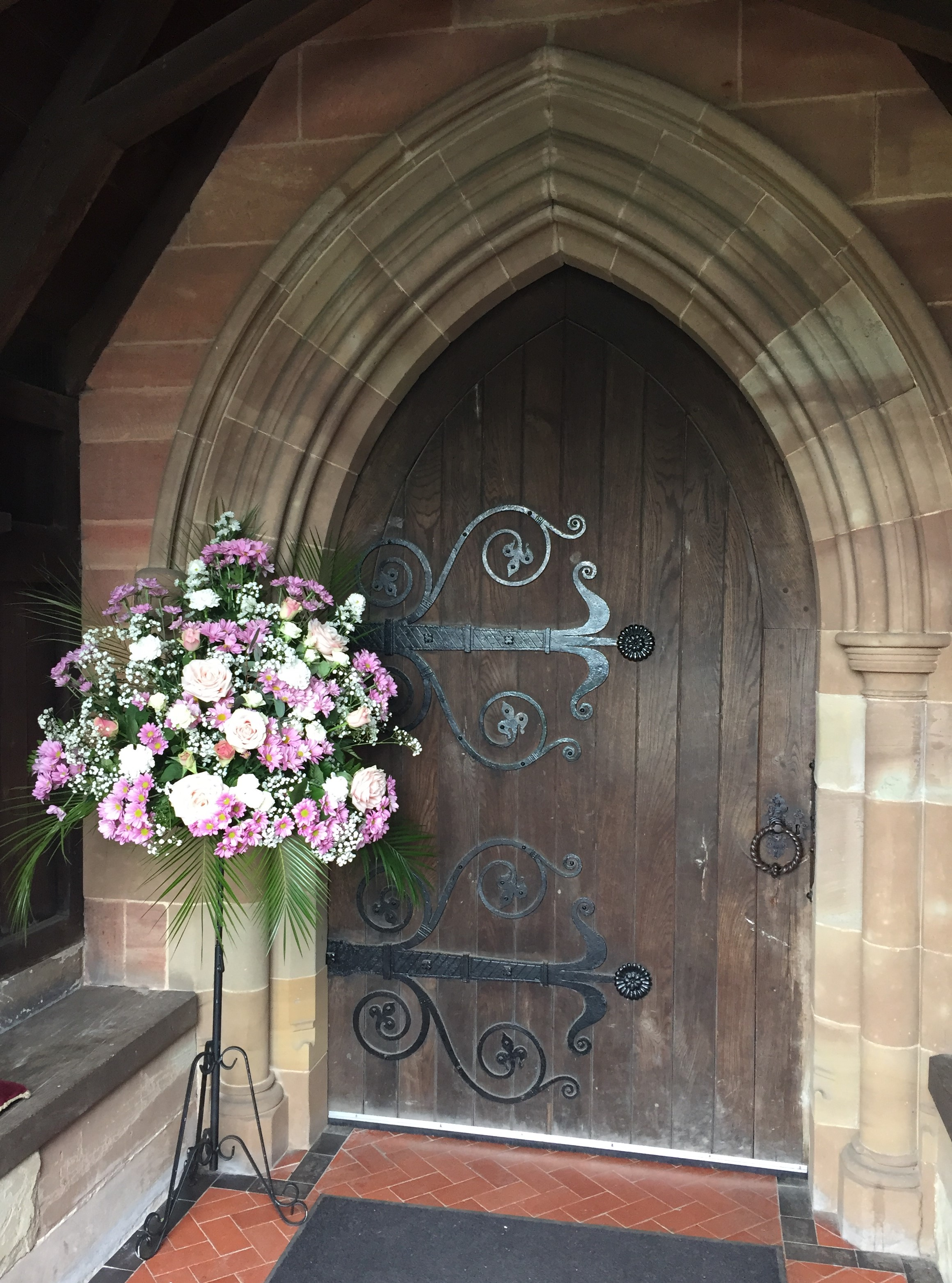 Pink & white pedestal arrangement church doorway