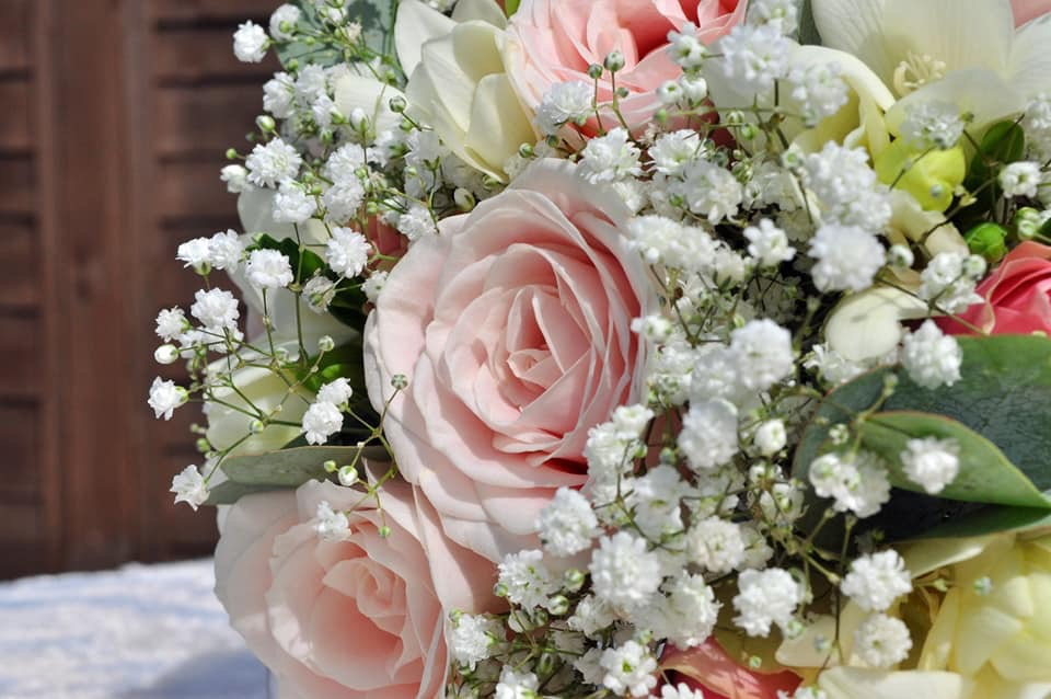bridal bouquet hand tied touches of gypsophila and roses with freesia  and alstro