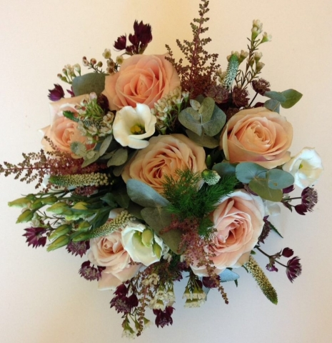 rustic wild theme wedding bouquet of roses lisianthus and freesia veronnica and wax flower and foliages