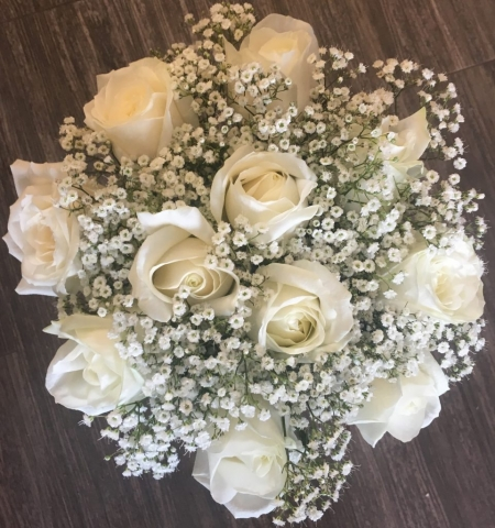 white roses hand tied with gypsophila in studley flair with flowers