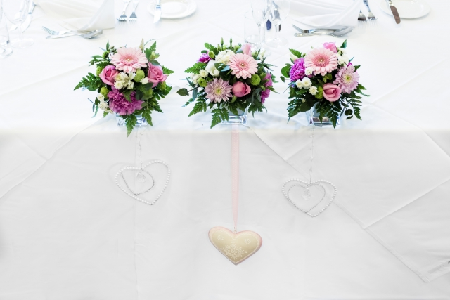 top table vase arrangements love hearts Abbey Hotel weddings