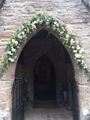 soft white flower church arch
