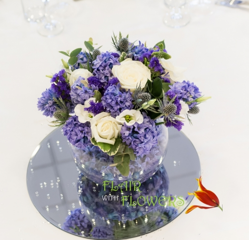 scented blue hyacinths & thistle Blue gold fish bowl arrangement Abbey Hotel