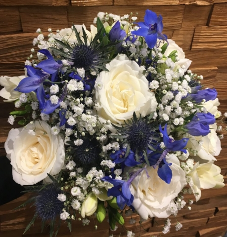 blue thistle ivory roses with blue delphiniums freesia scented bouquet
