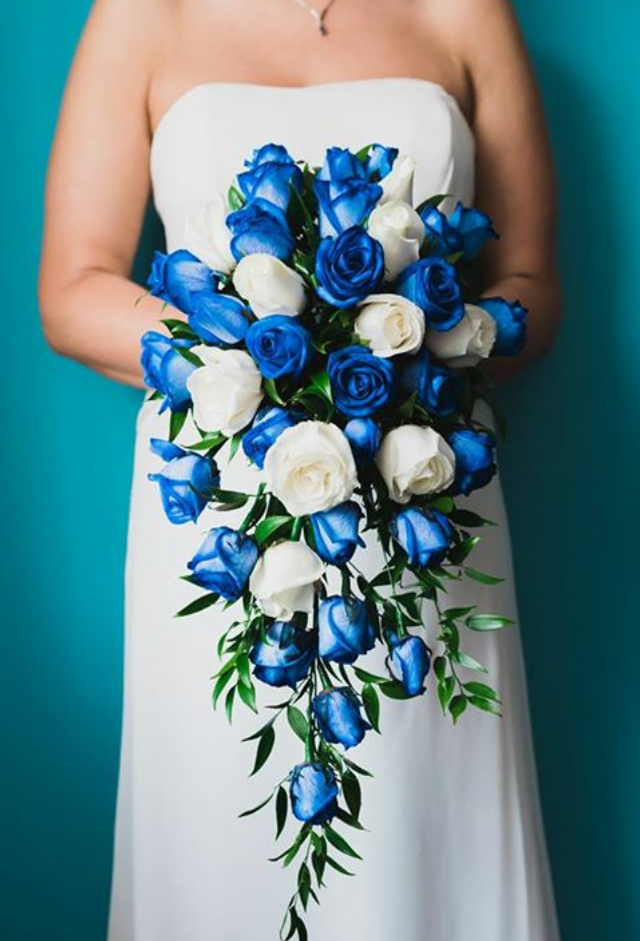 shower bouquet blue roses ivory roses soft ruscus