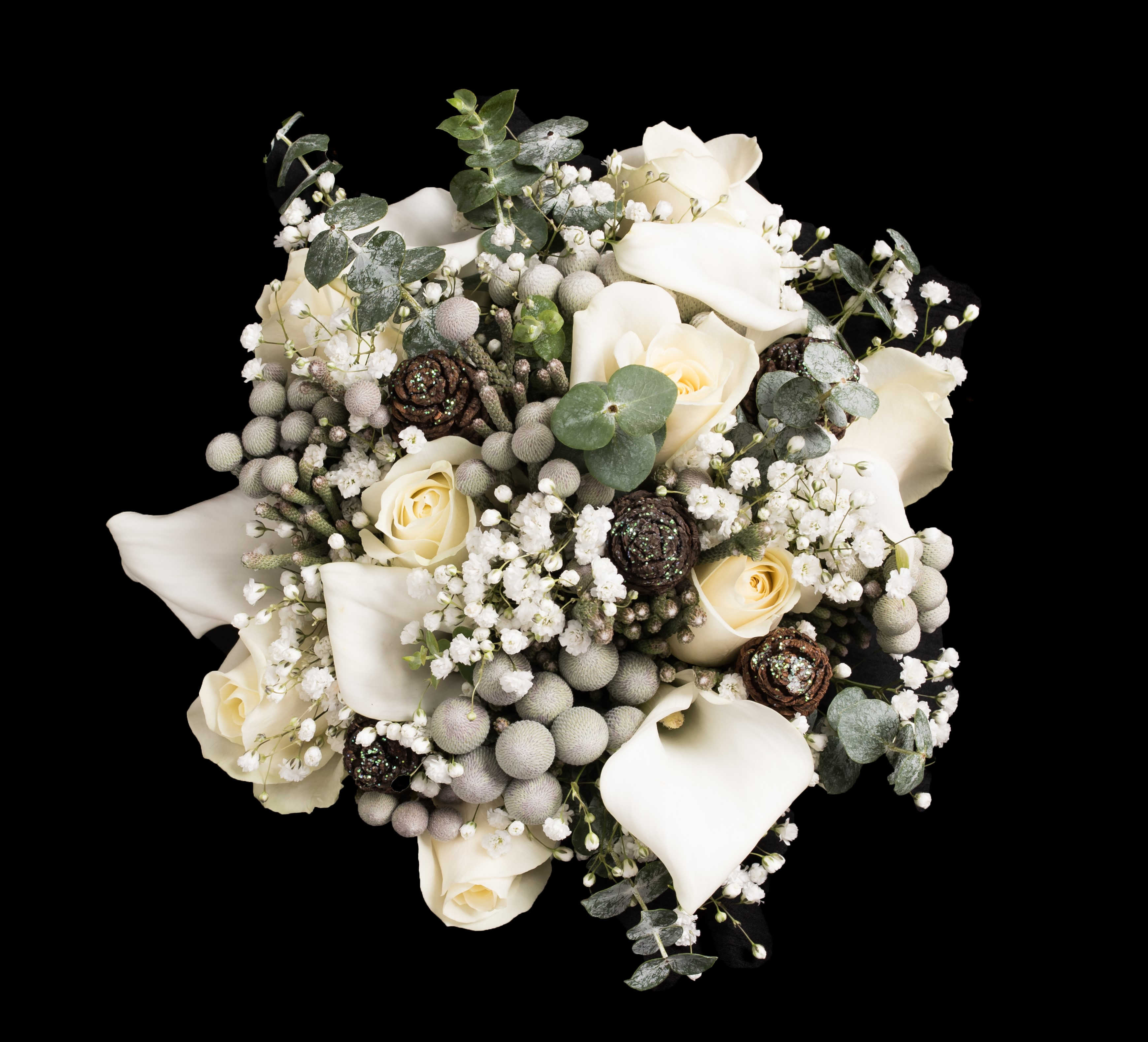 bridal bouquet of roses and ivory calla  gypsophila eucalyptus