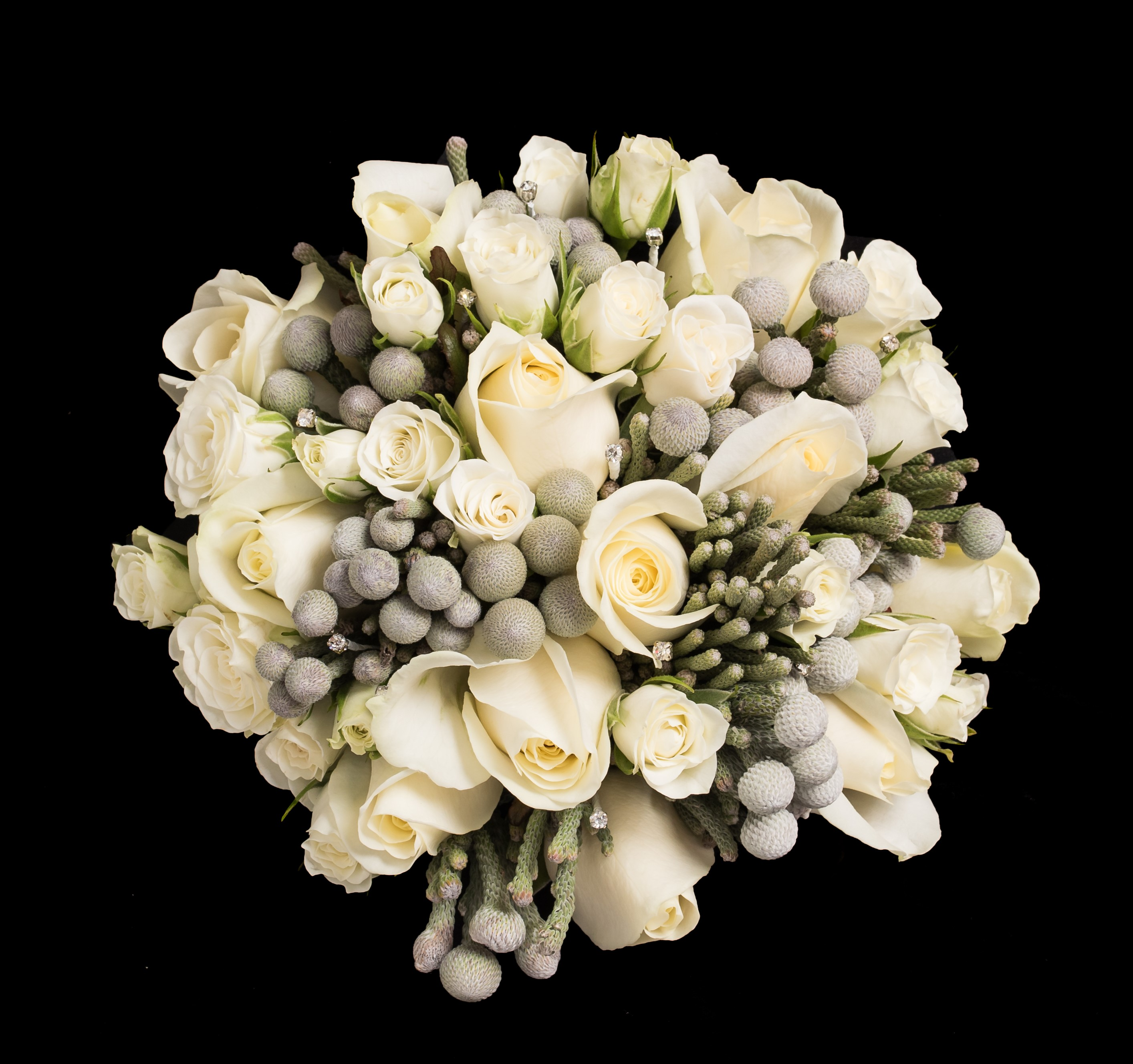 white roses and grey berries hand tied bouquet