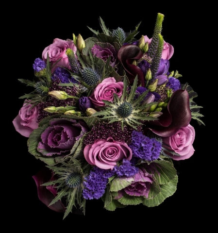 hand tied of roses thistle and lisianthus  freesia and veronica plum calla