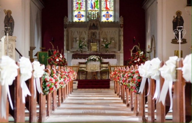 dressed church aisle red flowers red roses pew ends