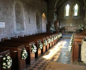 alter arrangement church dressings white flowered pew ends pedestal arrangements church aisle