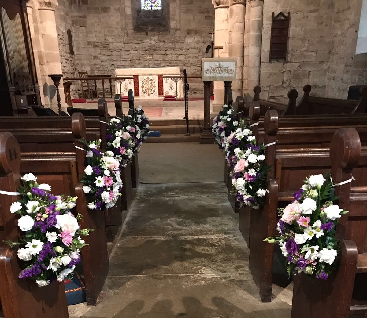 pink purple lisianthus pew ends in church