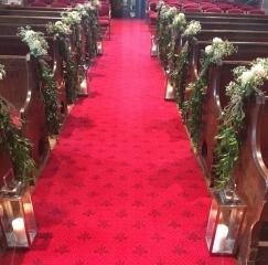 church aisle lanterns in church rustic foliage pew ends