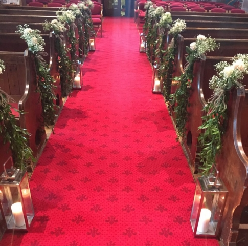 church aisle lanterns in church rustic foliage pew ends