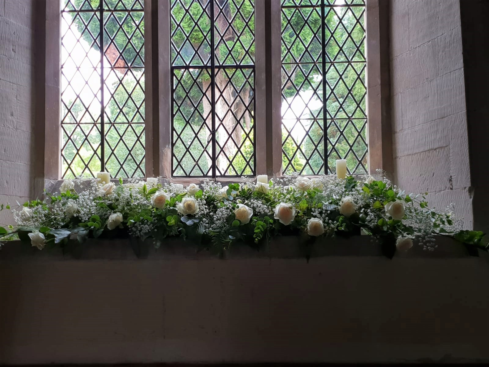 candles church window dressed white flowers